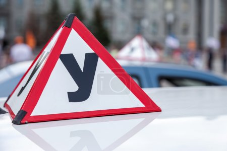 Photo for Sign of a Russian Driving School on top of the vehicle - Royalty Free Image