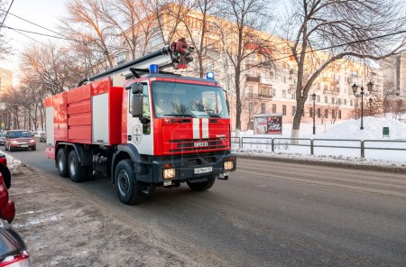 Red firetruck IVECO speeding down