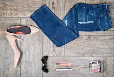 Flat lay picture of girls jeans and accessories
