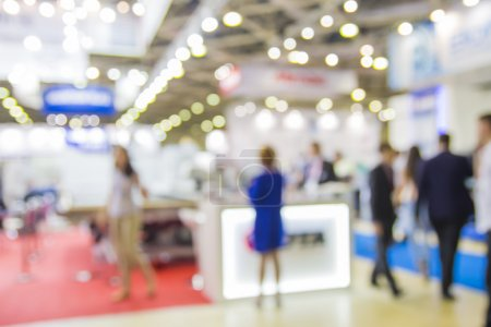 Photo for Trade show people, intentionaly blurred background - Royalty Free Image