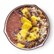 Breakfast banana and chocolate smoothie bowl toppe...