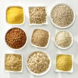 Various kinds of cereal grains on white wooden tab...
