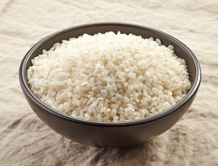 Photo for Bowl of raw round white rice - Royalty Free Image