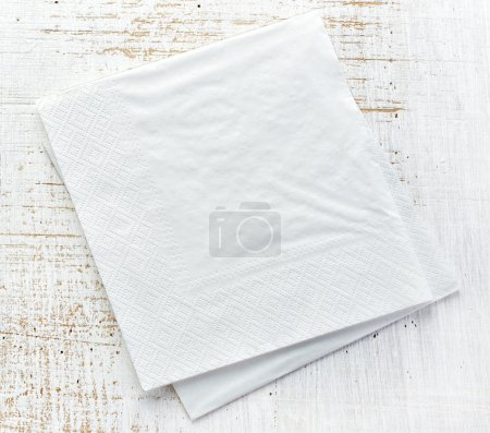 Photo for White paper napkins on old wooden table - Royalty Free Image
