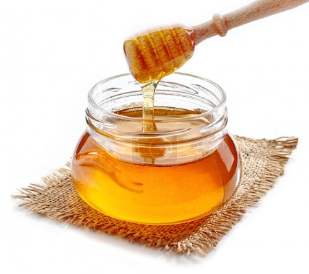 honey pouring into jar