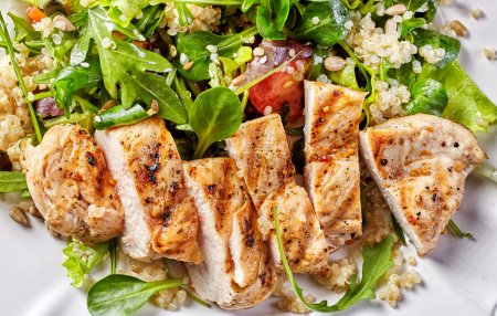 Photo for Quinoa and vegetable salad with grilled chicken fillet, top view - Royalty Free Image