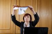 woman in the office shakes organizer