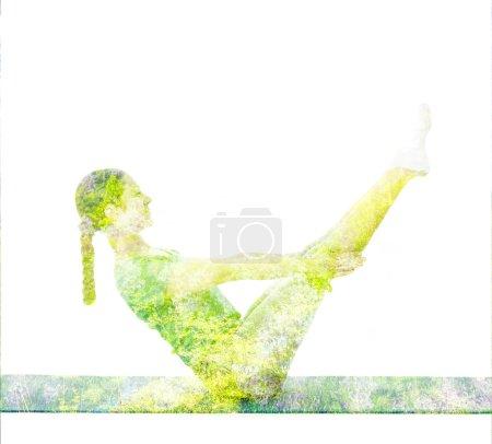 Double exposure image of  woman doing yoga asana