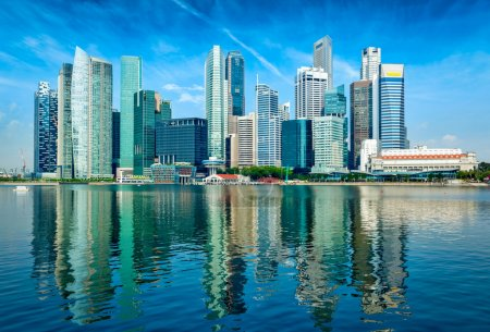 Photo for Modern Singapore city skyline of business district downtown in day with reflection in water - Royalty Free Image