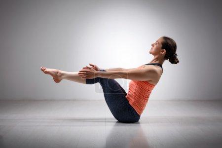 Sporty fit woman practices Ashtanga Vinyasa yoga