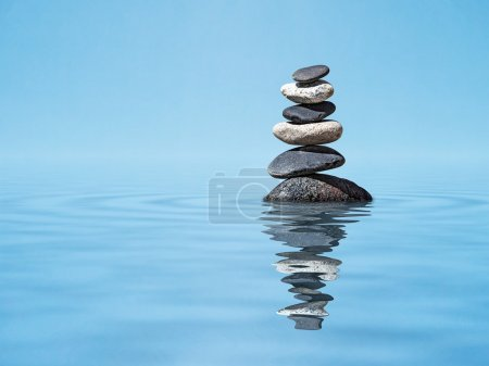 Photo for Zen harmony meditation relaxation peacefulness peace of mind concept background -  balanced stones stack in water with reflection - Royalty Free Image