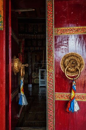Photo for Open leaf of gate of Spituk Gompa Tibetan Buddhist monastery with ornamented decorated door handle. Ladakh, India - Royalty Free Image