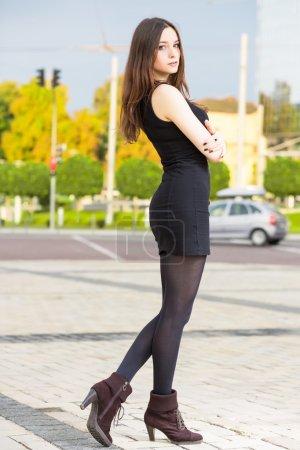 Pretty brunette wearing black dress