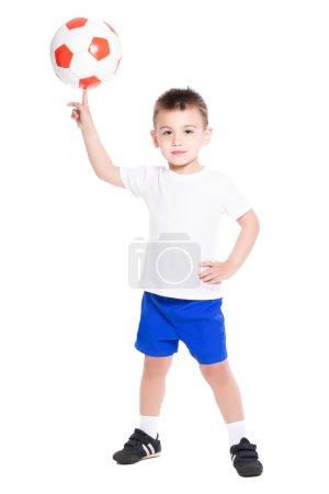 Football player holding ball on finger