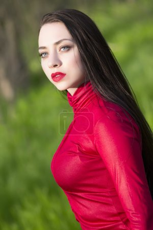 Thoughtful woman in red shirt