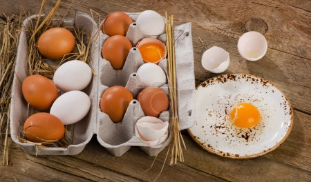 Photo for Raw eggs on rustic wooden table - Royalty Free Image