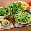 Foods highest in Vitamin K on a wooden board. Heal...