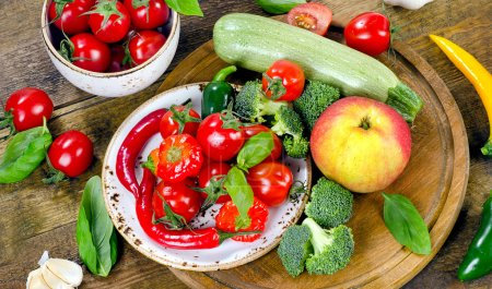 Different vegetables on wooden table.