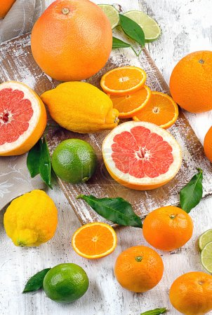 Photo for Different Citrus fruits on wooden table - Royalty Free Image