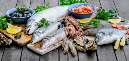 Fresh seafood on a wooden table.