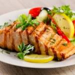 Grilled Salmon with fresh salad and lemon. Selective focus