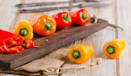 Fresh peppers on cutting board