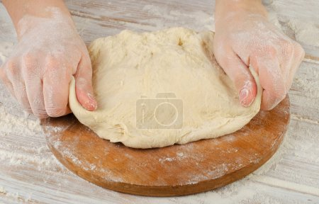Hands preparing dough