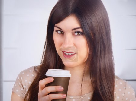 Woman with brown Coffee Cup