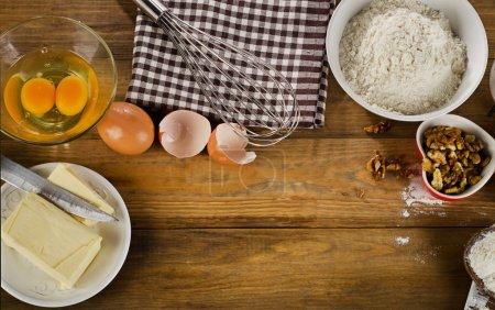 Baking ingredients on wooden background