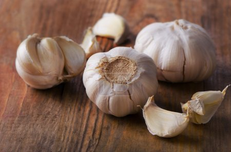 Organic garlic  on a old wooden background.