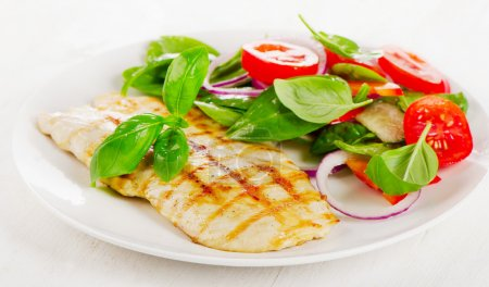 Photo for Salad with grilled chicken on white plate. - Royalty Free Image