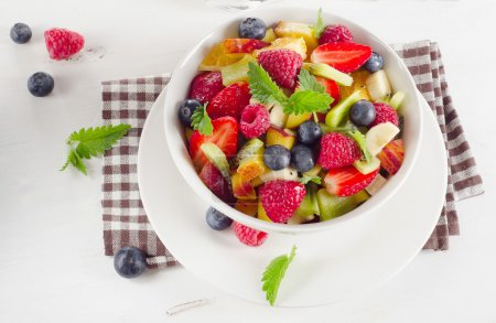 Photo for Close-up of salad with fresh fruits and berries. Healthy breakfast. - Royalty Free Image