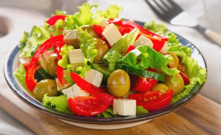 Photo for Fresh greek  salad with feta  . Selective focus - Royalty Free Image