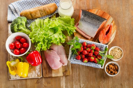 Photo for Balanced diet, healthy food concept on a wooden board. View from above - Royalty Free Image