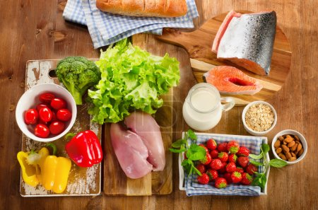 Photo for Balanced diet, healthy food concept on wooden board. View from above - Royalty Free Image