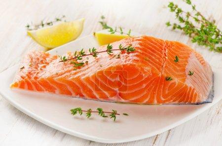 Salmon fillet on white plate