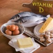 Foods containing vitamin D on a wooden background...