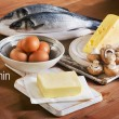Food containing vitamin A on wooden background...