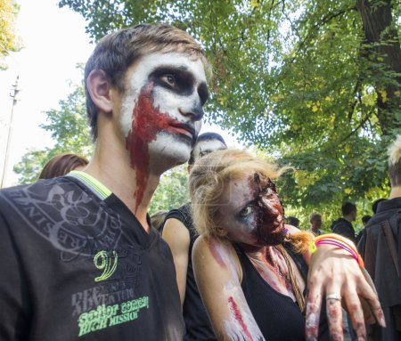 "Photo for People dressed as a zombie parades on a street during a zombie walk -- In Kiev passed the crowd of walking dead. One of the main requirements of the parade was, ''Let's eat brains, but reserve the mud!"" - Royalty Free Image"