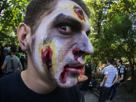 """Photo for People dressed as a zombie parades on a street during a zombie walk -- In Kiev passed the crowd of walking dead. One of the main requirements of the parade was, ''Let's eat brains, but reserve the mud!"""" - Royalty Free Image"""