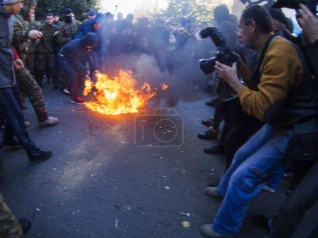Activists Avtomaydan lit a tire.