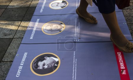 Women trampled portraits of politicians
