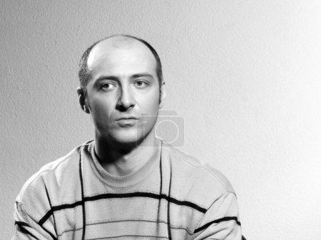 bald man in stripple jumper