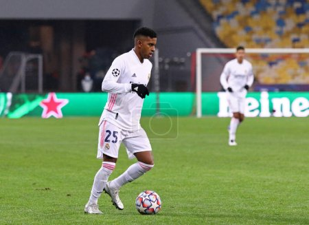 Photo for KYIV, UKRAINE - DECEMBER 1, 2020: Rodrygo of Real Madrid (R) controls a ball during the UEFA Champions League game against Shakhtar Donetsk at NSC Olimpiyskyi stadium in Kyiv. Real Madrid lost 0-2 - Royalty Free Image