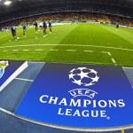 Постер, плакат: Board with UEFA Champions League Logo on the ground