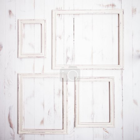 Photo for Shabby chic white frames on wooden wall - Royalty Free Image