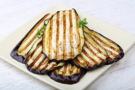 Photo for Effective Grilled eggplant with thyme on the plate - Royalty Free Image