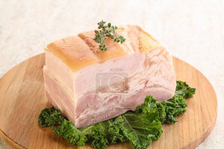 Photo for Cut of homemade pork bacon over board - Royalty Free Image