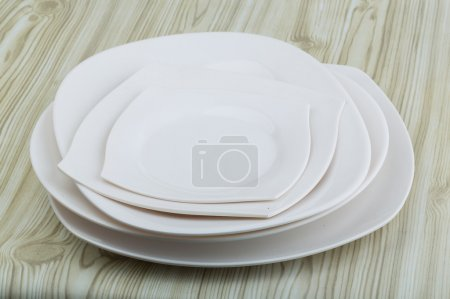 Photo for Empty White plates on the wood background - Royalty Free Image