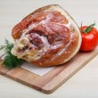 Smoked pork neck with dill on the wood background...